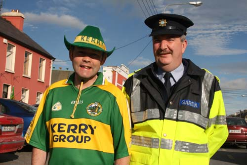 Fr.Gerard O'Leary and Garda Paul O'Donovan in Rathmore to welcome the Kerry team back into Kerry yesterday after their victory in the All-Ireland Football Final