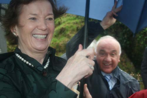 Helping Mary Robinson to hold on to her umbrella at the 2009 Commemoration Ceremony at Béal na mBláth where this year the weather was so very wet and windy