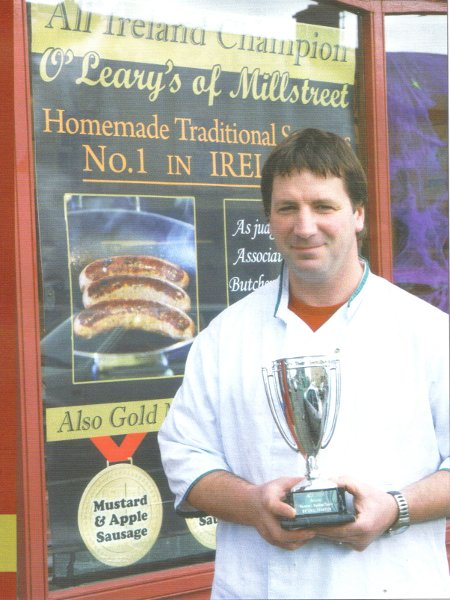 "James O'Leary pictured with the cup he received for ""All-Ireland Supreme Sausage Maker"""