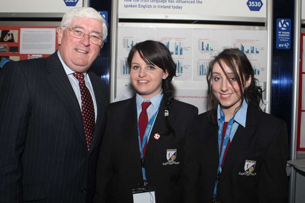 Eveny Costello and Muireann O'Keeffe from Millstreet Community School with Minister Batt O'Keeffe at the BT Young Scientist and Technology Exhibition in the RDS