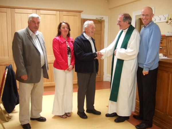 Dan Duggan bids farewell to Canon Declan. Also included (from left) - Martin Cleary (Sacristan), Sharon Lane (Parish Secretary) and Fr. James McSweeney.