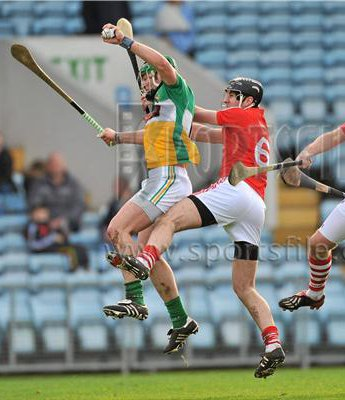 2011-02-13 Joe Bergin (Offaly) beats Mark Ellis to the ball in the NHL game between Cork & Offaly