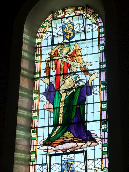 "The two letters seen at the top of this magnificent stained glass window in St. Patrick's Church, Millstreet read as ""S"" and ""P"" to signify that the window features St. Patrick and an Angel."