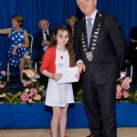 2012-06 Tim Buckley of Kerry County Council Presents to Tia Kiely U9 Competitions for her poem - the Dancing Principal - at Listowel Writers Week