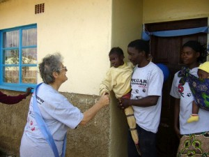 2012-12-14 Sr.Mary Lucy greets a family in their new house in Zambia