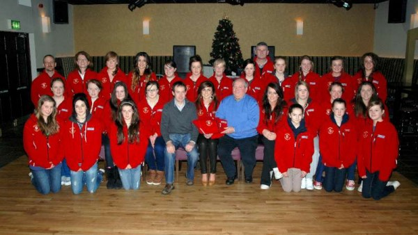 2012-12-22 Presenting fleeces for Millstreet Camogie Club - The Minor and U16 Camogie teams and trainers with Frank and Derry Casey