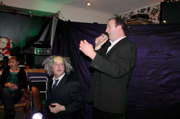 """Diarmuid and Séamus Long of  """"Madcaps"""" during one of their many send-ups of well known celebrities at the capacity filled Pub in Carriganima on Saturday night.   (S.R.)"""