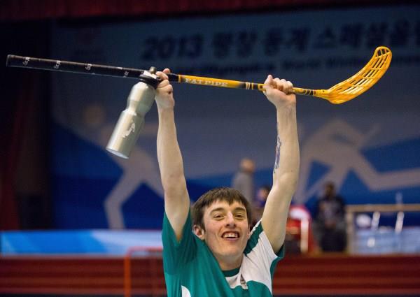2013-01-31 The Irish Floorball Team at the Special Olympics in Korea - Brendan O'Sullivan raises his stick in victory