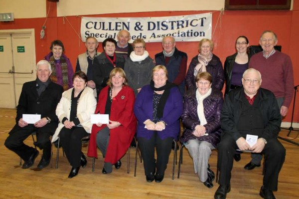 The first night of Cullen & District Special Needs Association's Weight Loss Programme begins with the presentation of a number of much appreciated cheques to Organisations such as COPE and others.   Representatives of many of those praiseworthy Groups are pictured here with member of the Cullen & District Co-ordinating  Group at Cullen Community Centre on Monday, 21st Jan. 2013.   (S.R.)