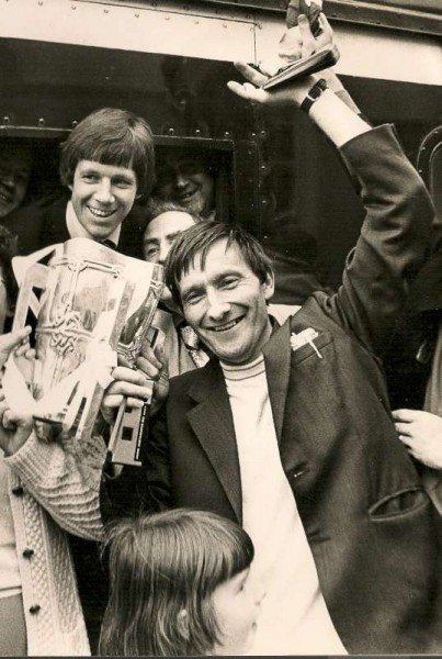 Michael Looney in joyful spirits as he is pictured with hand in air holding the All-Ireland Cup which Cork had just won c1977