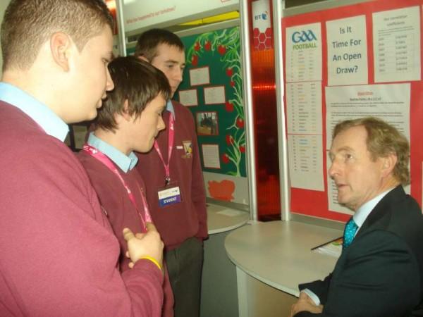 Darragh Hickey, Seán O'Callaghan and Nathan Harman explain their G.A.A. Ranking Algorithm to Taoiseach Enda Kenny.