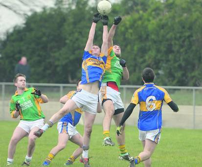 2013-03-03 Who's for the ball between Cullen and Millstreet in the Ducon Cup in Cullen. Picture John Tarrant in the Corkman