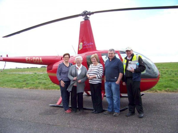 Pictured at Cork Airport with daughters Noreen and Geraldine and son, John D. - Eily Buckley together with the pilot was absolutely thrilled with her helicopter trip 80th birthday surprise.  (S.R.)