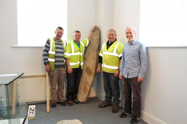 A milestone in so many ways was marked at Millstreet Museum in the Carnegie Hall today (13th June 2013) as the famous Liscahane Ogham Stone was expertly transported and put in position by the superbly obliging members of Millstreet Branch of Cork Co. Council.   We thank the men who faced and overcame the challenge of such a very heavy historic stone.   Special thanks also to Denis O'Shea of C.C.C. who could not have been more helpful.   We were delighted to welcome Barry and Dominic from Storefit, Cork who are so expertly constructing our new Centre with new glass units and shelving over today and tomorrow.  When all our units are in place Mary Kelleher, Mary Cronin and I will certainly have a very busy time filling the various shelves, adding labels, signage etc..  So the re-opening of Millstreet Museum and Tourist Information Centre moves a significant step closer.  (S.R.)