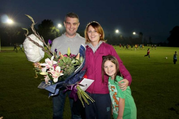 Pictured with Fía - Mícheál Hurley and Catherine Kenneally express their delight at the surprise presentation which they received from the parents and children associated with Millstreet Camogie Teams.   The marvellous event took place in Millstreet Town Park on Monday evening to mark the upcoming wedding of Mícheál and Catherine on 3rd October 2013.  Click on the images to enlarge.  (S.R.)