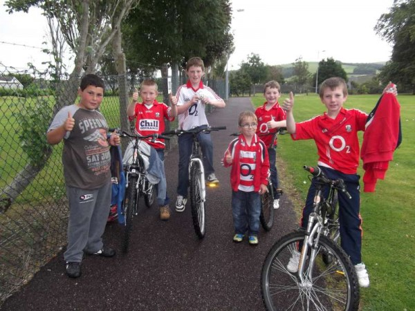 These enthusiastic young Cork supporters in Millstreet Town Park this evening look forward to the Replay between Cork and Clare on 28th September 2013.  The Red and White displays will remain in place!  Click on the images to enlarge.   (S.R.)