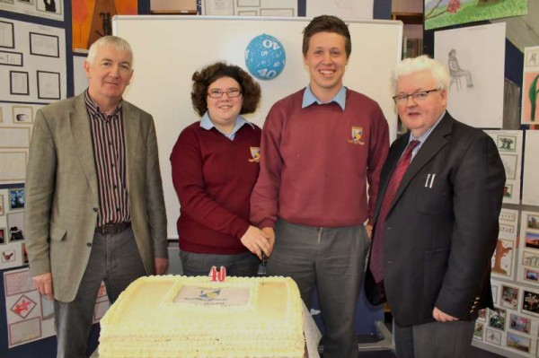 On Wednesday, 23rd October there was a very special school celebration of the 40th Anniversary of Millstreet Community School. Principal Pat Pigott addressed the Students and Staff outlining the history of the school.   Here we note the cutting of the very impressive cake by Nora O'Sullivan whose grandmother, Nora Creedon was a wonderfully dedicated Parents' Committee Leader in the early days of the school while Donagh Murphy's grandfather, Michael O'Keeffe was superbly involved as Leader in the actual building of the school pre-1973.   Click on the images to enlarge.  (S.R.)