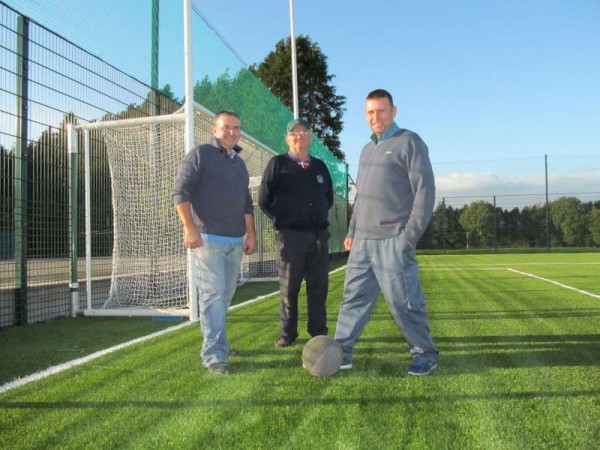 "The ""3 Js"" - John D.(Buckley), Jerry (Lehane) and Jeremiah (Keating) had the unique privilege on Friday evening of being to first to play ball on the absolutely magnificent new Astroturf pitch....and they promised to wear the correct shoes for the superb surface on the next occasion they will play there!   Cllr. Noel Buckley and Friends then joined the players to express their delight at the marvellous new sporting facility which has become a reality in Millstreet.   Click on the images to enlarge.  (S.R.)"