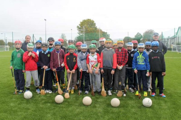 Pictured with Principal, Frank O'Connor (on left back) and Coach, Michael McCarthy - here we view some of the enthusiastic pupils of Scoil Mhuire, Millstreet B.N.S. playing on the ultra-modern Astro Turf Pitch which is situated near their National School.   Although it began to rain as we took our pictures today (24th Oct. 2013) it is clearly evident how very thrilled the young Students are with this marvellous new sporting amenity.   Click on the images to enlarge.  (S.R.)
