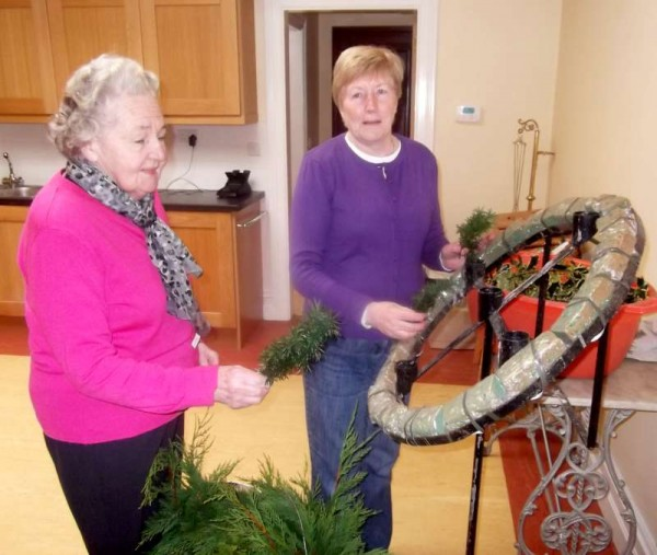 Dedicated and wonderfully creative members of Millstreet Altar Society - Kitty Cronin of The Rectory and Teresa Kelleher of Liscahane prepare this  year's Advent Wreath to have it ready for the First Sunday in Advent.  Click on the image to enlarge.  (S.R.)