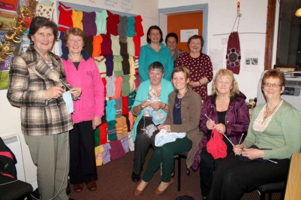 "Coordinated by Áine (seated second from left) the Millstreet ""Knit Together"" Group (pictured) in association with Millstreet Active Retirement Group has just completed a superb project at their centre in Main Street, Millstreet where over the past number of weeks they have very creatively knitted several colourful ""Fish and Chips"" Jumpers for babies in Albania.   Sincere congratulations to All who have supported the ""Heart to Hand"" Foundation in such a very practical manner.   Many thanks to Breeda Cronin (standing on extreme right) for alerting us to this most inspiring work.   Click on the images to enlarge.  (S.R.)"