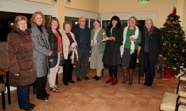 """Margaret McCarron (Bandon & Cullen) - 5th from left in our picture - presented an exquisite Christmas Programme of Music and Song on Friday, 13th Dec. in the Canon O'Donovan Centre, Millstreet.   The proceeds of the Draw which amounted to €65.00 is going entirely to """"Mad Hair Day"""" organised by local Primary Schools in aid of the Philippine Disaster Fund.  Click on the image to enlarge.  (S.R.)"""