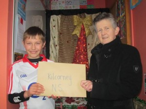 2013-12-17 Kilcorney N.S. Pupil Evan Murphy presenting Angela Bourke (St.Vincent de Paul) with their donations from their Christmas Nativity
