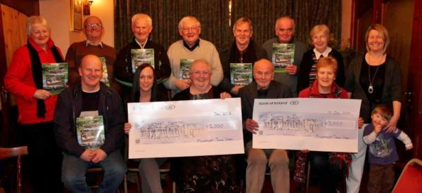 """Following the superb success of the publication of """"Down the Lawn"""" by Millstreet Town Park two very impressive cheques of €2000.00 were presented to both Millstreet Community Hospital and to the Millstreet Branch of the Society of St. Vincent de Paul at Corkery's Bar, West End on Monday night.   Click on the images to enlarge.  (S.R.)"""