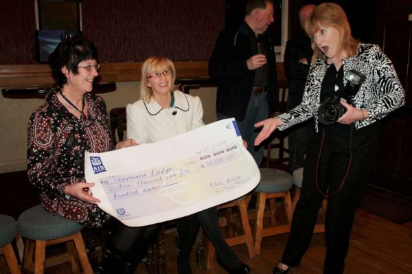 "Photographer supreme, Sheila Fitzgerald, expresses her amazement at the hugely impressive cheque of €16,500.00 being presented by Ailish Coakley following the wonderfully successful ""Robinson Crusoe"" Rathmore Pantomime 2014 to Gillian Kenny representing the Tarman Centre, Rathmore.  More pictures to follow later.  Click on the images to enlarge.  (S.R.)"