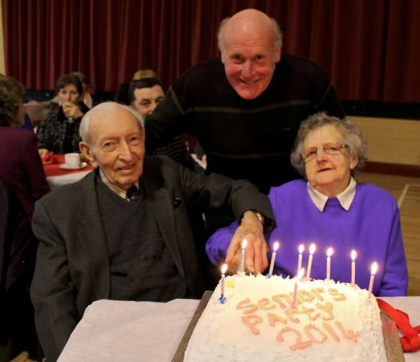Fr. Liam Comer with Ted Collins, Knockcahill, Rathcoole and Julia Dunne, Dysert, Dromagh - the two most senior people at Sunday's Dromtariffe Seniors Party 2014.