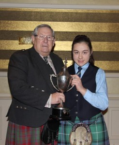 2014-03-07 Ciara O'Connor of Cullen Pipe Band - winner of the beginner Piobaireachd in Mitchelstown - with Tom Speirs of Edinburgh who judged the event