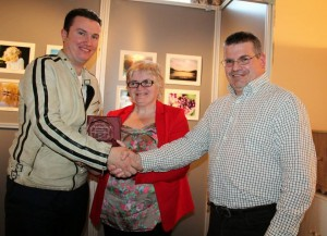 2014-05  John F Kelleher won Best Flower Photography at Bealtaine Festival receiving his award from Justin Black