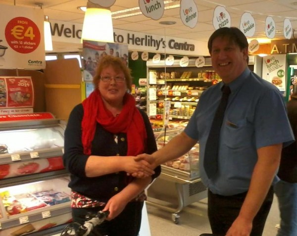 2014-06-07 Eileen Kelleher of Dromsicane, receives her prize of a bike from Greg Kuderski, Manager, Herlihy's Centry
