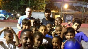 2014-06-10 Conor Hartnett with Carlao and kids at their concrete pitch in Rio