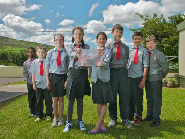 """""""Cloghoula N.S. pupils displaying the plaque , won for excellence in global awareness at the regional Our World Irish Aid Awards ceremony held in Cork recently."""" Photo by Justin of Justborn Photography, West End, Millstreet."""