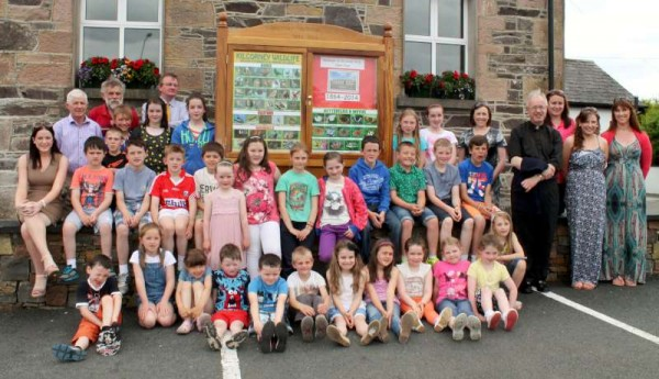 What a truly superb occasion it was at Kilcorney N.S. on Sunday, 22nd June 2014 when Principal, Con Meade, Staff and Parents' Committee with Board of Management organised a magnificent 150th Anniversary Celebration.   Here we share highlights of the historic event.   I even found in their excellent Museum Exhibition the 1963 English Paper of the Primary Cert which I recall doing on that very year!  Click on the images to enlarge.  (S.R.)