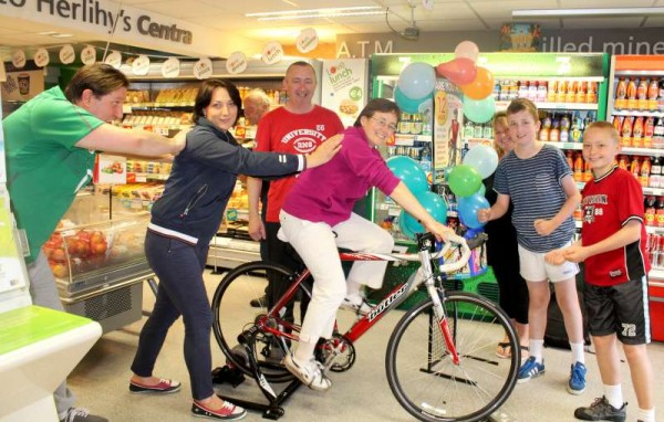 On this American Independence Day, 4th July 2014 at Herlihy's Centra, Millstreet a very successful Cyclothon took place.  Here we note Liz Healy receiving lots of encouraging and support in her valiant participation.  Click on the images to enlarge.  (S.R.)