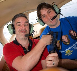 John McGuire (Fat Tony's Barber Shop) preparing for the shave with JP Randles (GFC) in Galway Flying Club's cessna 172