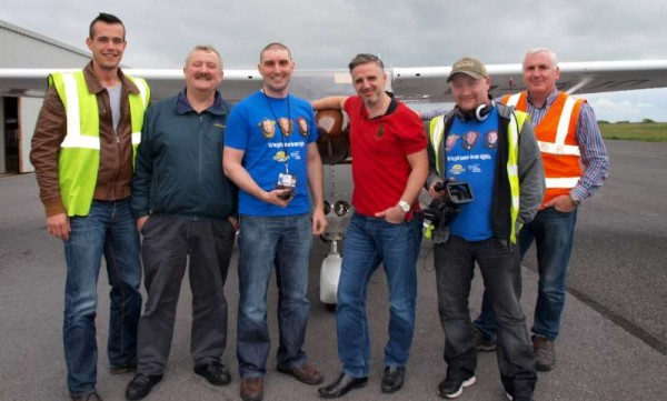 The crew - Daniel Varszegi (GFC), Jarlath Conneely (GFC), JP Randles (GFC), John McGuire (Fat Tony's Barber Shop), Nigel O'Brien (Libran Pictures) and James Prendergast (GFC) - in front of Cessna 172 EI-BJO.