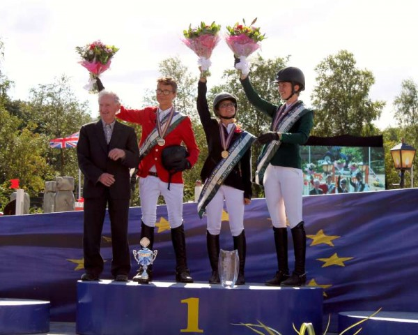 Our picture says it all!   All Champions on the final day of the hugely successful European Pony Championships 2014 in Millstreet.  Noel C. Duggan expresses his delight on the remarkable five day event in Millstreet where world-class equestrian facilities enormously impressed the many European Visitors.  Here Noel C. joins the winners at the final presentation event - Beligium (silver), France (gold) and Ireland (bronze).  Over the next few days we shall catch up on sharing the many pics from the past fortnight in Millstreet including a special pictorial selection from Denis O'Regan.   Click on the image to enlarge.  (S.R.)