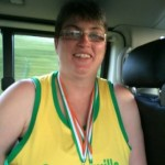 2014-08-11 Eileen O'Riordan with her two gold medals form the All Ireland Masters Track and Field Championships