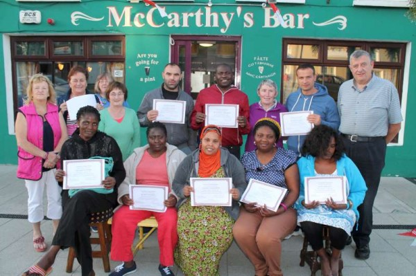 A truly international celebration at Drishane and at The Square, Millstreet as special Certificates of Appreciation were presented to the many wonderfully helpful international people who assisted Millstreet Tidy Towns Association over the past nnumber of weeks.  Businesses in  The Square sponsored a most enjoyable barbeque on the Square Plaza in glorious weather on Wednesday evening, 20th August 2014.   Click on the images to enlarge.  (S.R.)