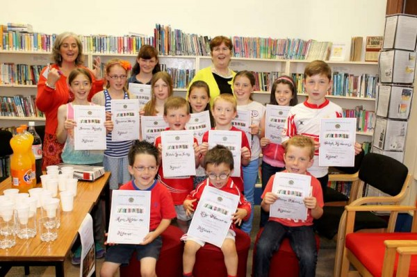 On Saturday, 27th Sept. 2014 Michelle O'Keeffe presented splendid certificates to the many young people who participated in the 2014 Millstreet Library Summer Reading Challenge.  Librarian, Breda had a special Book Token for Claire Lyons having won this award.   Then followed a Sweet Treat Party in celebration.  The enjoyable event was held under the auspices of the Cork Co. Library & Arts Service.  Click on the images to enlarge.  (S.R.)