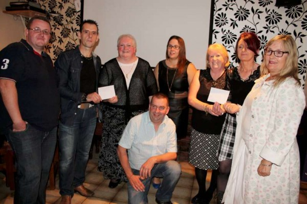 The wonderfully uplifting result of the recent annual Carriganima Fundraising Walk saw the presentation at The Pub in Carriganima on Saturday, 11th Oct. 2014 of €1,000.00 to both Millstreet & Macroom Hospitals.  From left: Jimmy Murphy, Matron Lena Kelleher (Millstreet), Margaret Pierce, Marie Good, Ann Marie Murphy, Matron Bernie Buckley and in front a further member of the Organising Committee, Seán Murphy.  Click on the images to enlarge.  (S.R.)