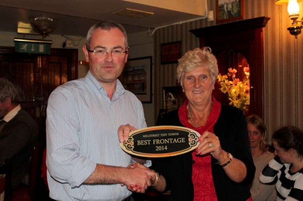 "Chairman of Millstreet Tidy Towns Association presents the prestigious Best Frontage Award 2014  to Ursula Pomeroy of ""The Clara Inn"" at the special Awards Event held in ""The Clara Inn"" on Wednesday, 1st Oct..  Click on the images to enlarge.  (S.R.)"