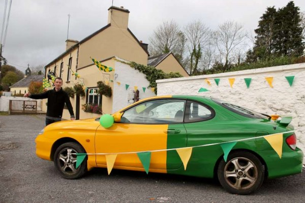 "Matthew Neville at The Pub in Carriganima with the ""Millstreet Car"" wishing the Team every success in the County Final on Saturday.  Click on the images to enlarge.  (S.R.)"