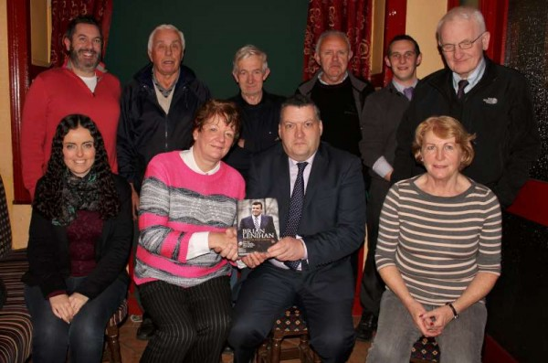 "A presentation of the book ""Brian Lenihan - In Calm and Crisis"" was made by Chairperson of the Millstreet Fianna Fáil Cumann, Maria Murphy, to Cllr. Bernard Moynihan marking his recent election to Cork Co. Council.  Also present were further dedicated members of the Millstreet Cumann.  Click on the images to enlarge.  (S.R.)"