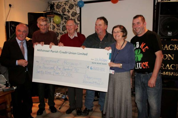 "The official presentation of the Marymount Fundraising Cheque took place in The Pub, Carriganima on Friday, 24th October 2014.  Carmel Ryan who accepted the very impressive cheque on behalf of The Friends of Marymount Hospice expressed her sincere thanks for the €6,523.22 (further increased by €650.00 from Pub donations on the night).  ""Back on Track"" provided superb musical entertainment on the night.  Click on the images to enlarge.  (S.R.)"