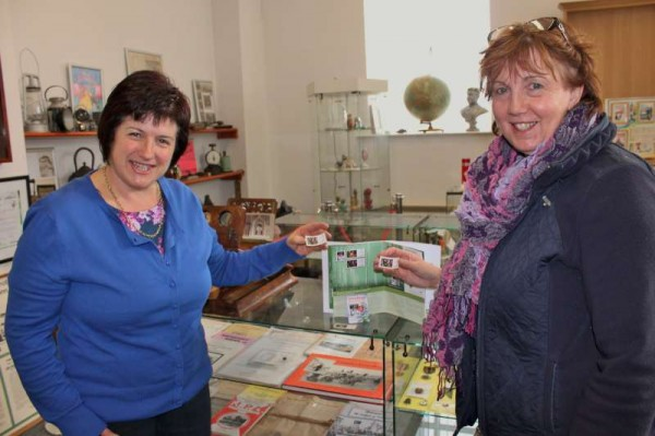 Patricia Moynihan of An Post shares the truly historic occasion of the now famous Millstreet Christmas Stamp arriving in Millstreet on Tuesday, 11th Nov. 2014 - Patricia (on right) is pictured at Millstreet Museum .  Below we observe the stamp which was presented by Patricia to Millstreet Museum and we also share an image of the Church Window where we note the detail on the second division showing the angel with the blue halo on the left.   Click on the images to enlarge.  (S.R.)