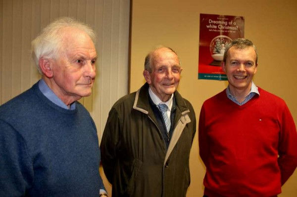 William Kiely (in red) with the two Founder Members of Millstreet Credit Union - From left: Dermot Kiely and Liam Coffey.